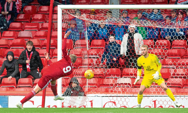 Aberdeen's James Wilson has a first half chance which clips the bar against Celtic at Pittodrie
