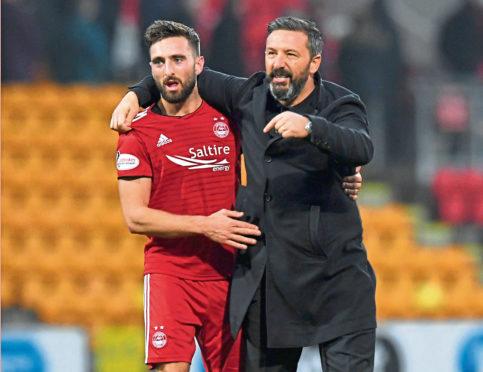 Aberdeen's Graeme Shinnie with manager Derek McInnes.