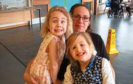 Maggie Conner with daughters, Megan, left and Leah, right