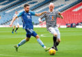 Ryan Dow takes on Queens Park's Gerry McLachlan while he was with Peterhead.