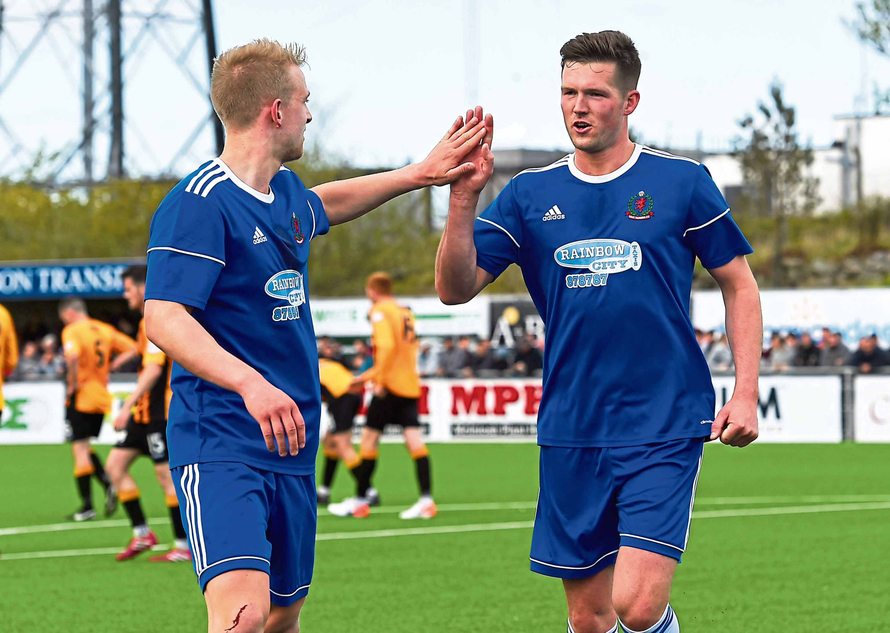 Goalscorer Jordon Brown, left, celebrates with team-mate Jamie Masson after making it 4-0 to Cove Rangers.