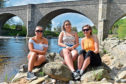 Sunbathing at Potarch Bridge, Banchory, are, from left, Ellie Mitchell and Chantelle and Chloe Low