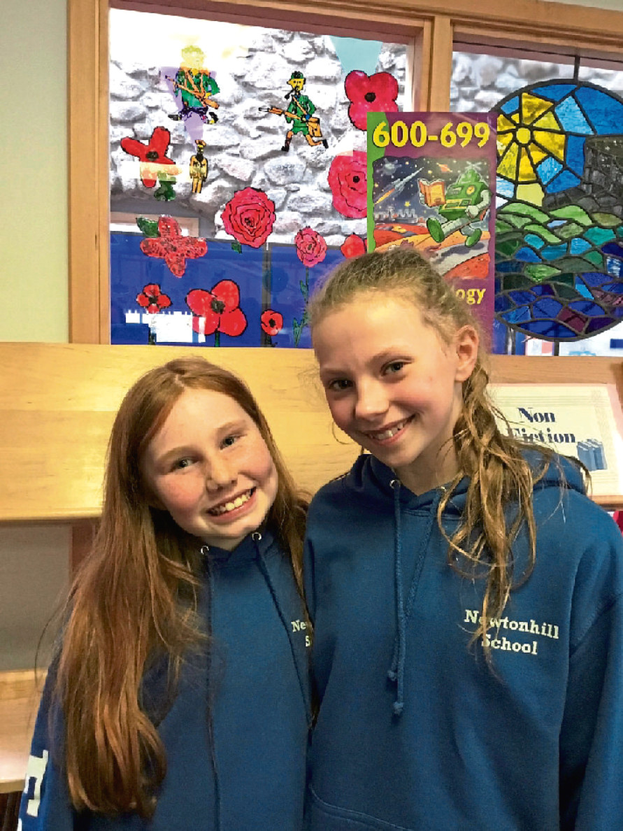 Esme Forsyth and Eva Combe from Newtonhill School, who won a Poppyscotland competition asking pupils to present how they would report the end of the First World War if it happened in the modern day