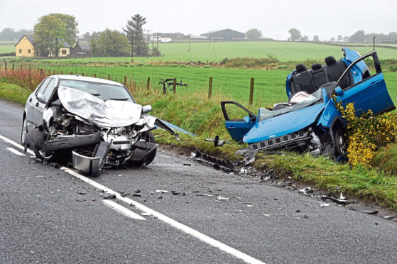 Three people had to be freed by firefighters after a collision between two vehicles on the A947 near Dyce