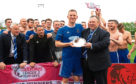 The Cove Rangers squad celebrate winning the Ladbrokes League 2 play-offs in summer 2019 as chairman Keith Moorhouse makes presentation to departing Cove skipper Eric Watson.