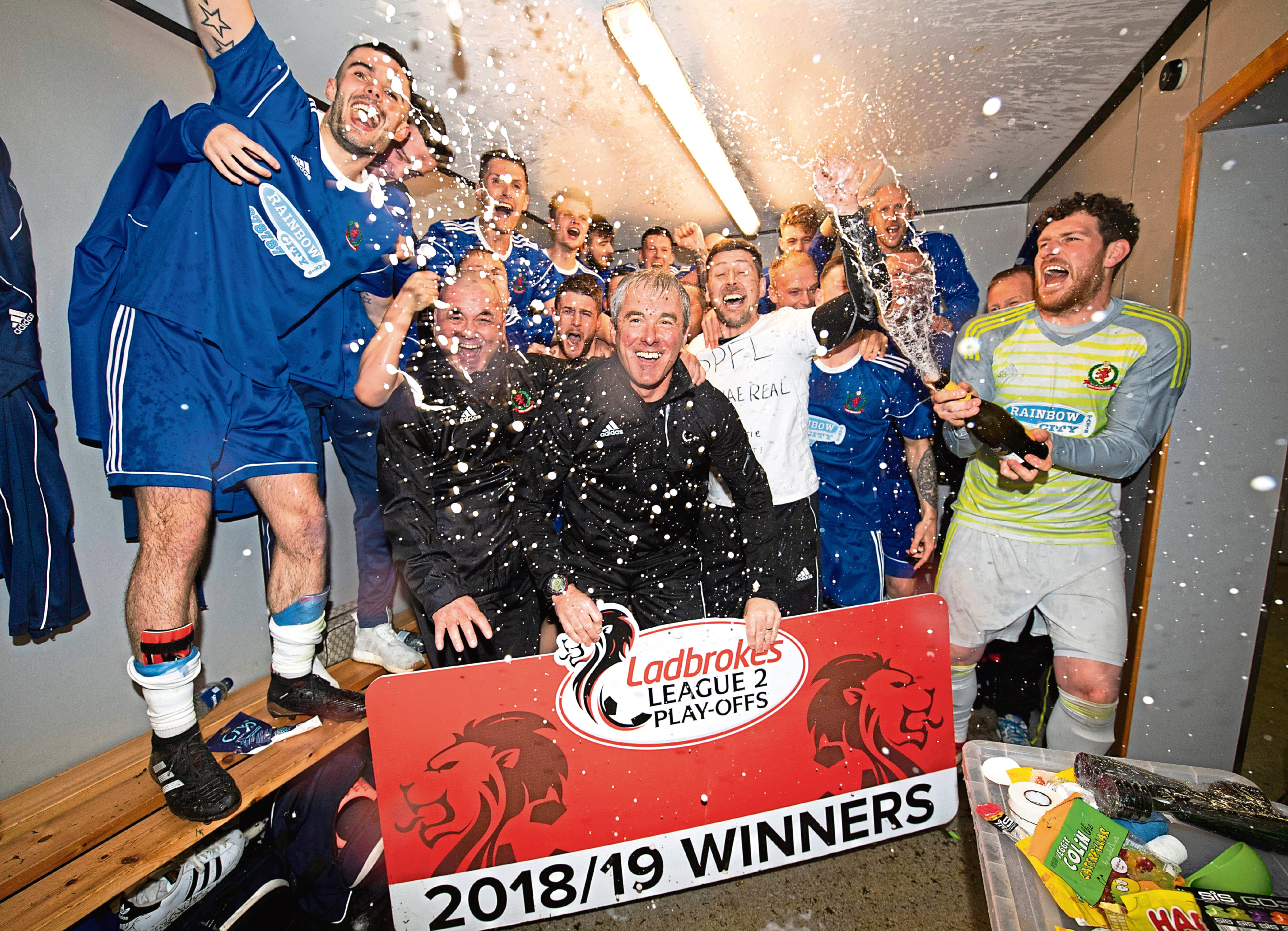 The Cove Rangers squad celebrate winning the Ladbrokes League Two Play-Offs