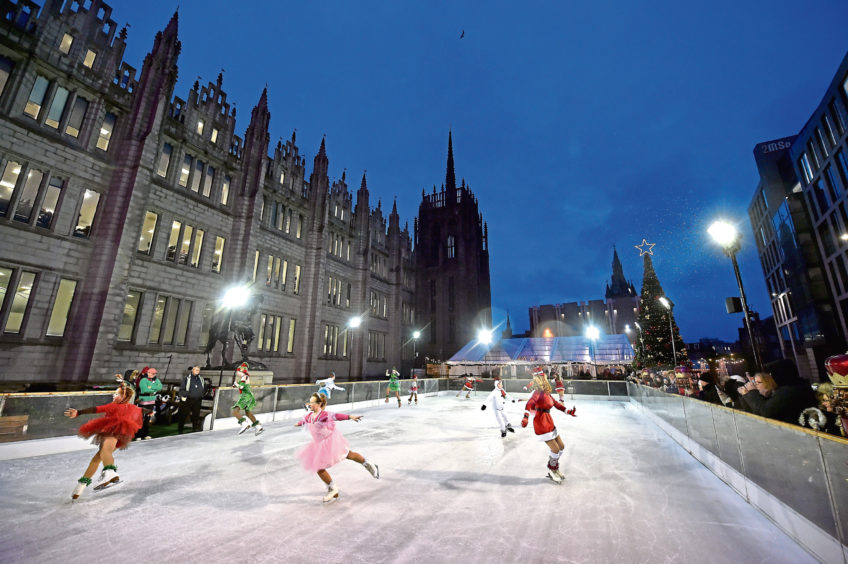 Performers at the Aberdeen Christmas Village ice rink