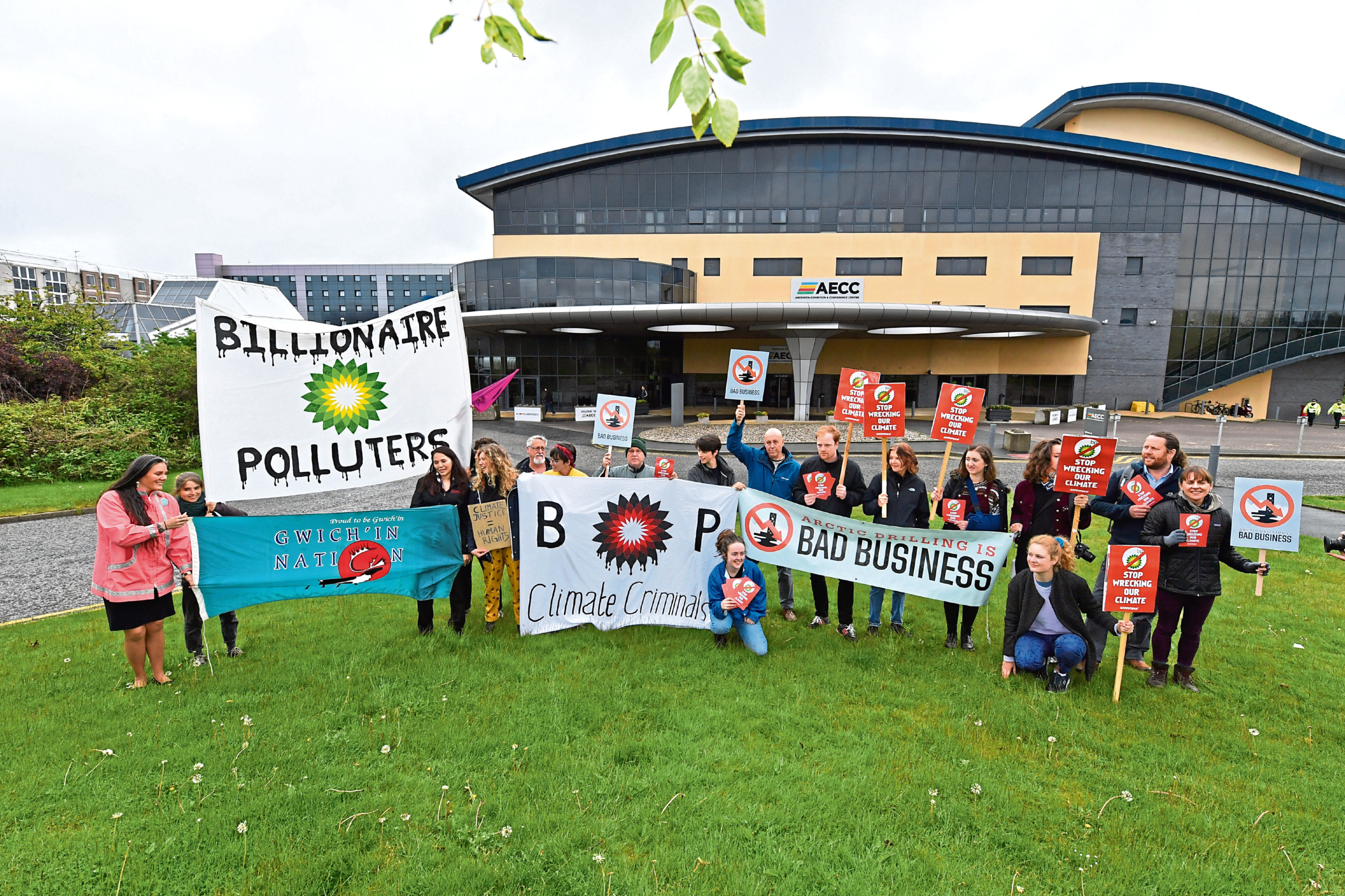 Members of Friends of the Earth gathered at BP's annual general meeting at the AECC