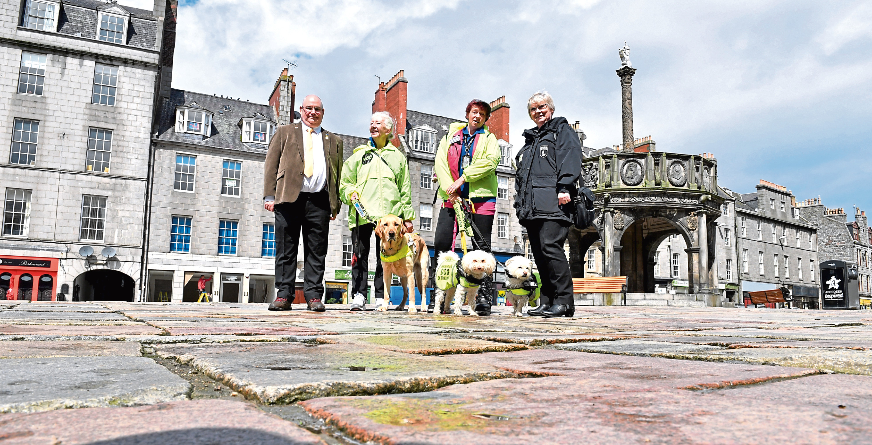 From left, Councillor Dell Henrickson, Mary Rasmussen with Vince, Ells McHaffie with Alfie and Blossom, and Pamela Munro at the Castlegate