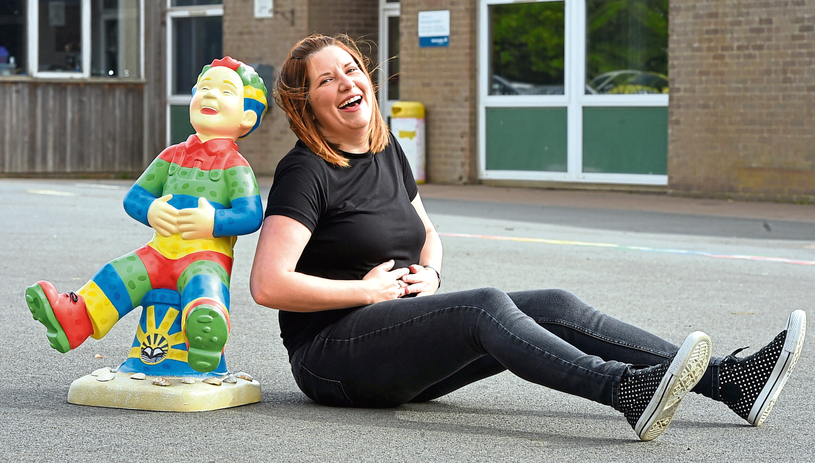 Parent and project co-ordinator Alison Farrell has a giggle beside Balmedie School's brightly-coloured Oor Wullie sculpture.
