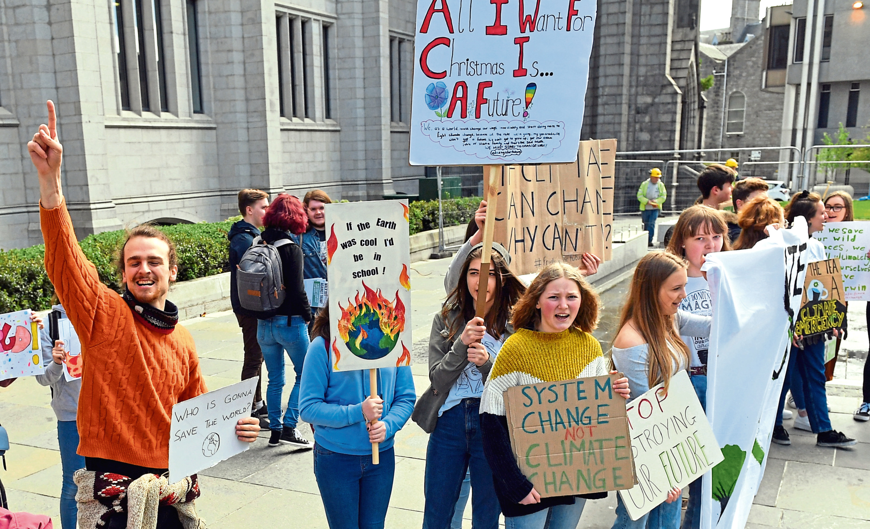 Students gathered in front of Marischal College to demand climate action.