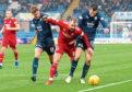 Aberdeen's Niall McGinn (centre) evades Dundee's Ryan McGowan and Ethan Robson