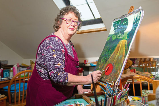 Artist Alison at her easel
