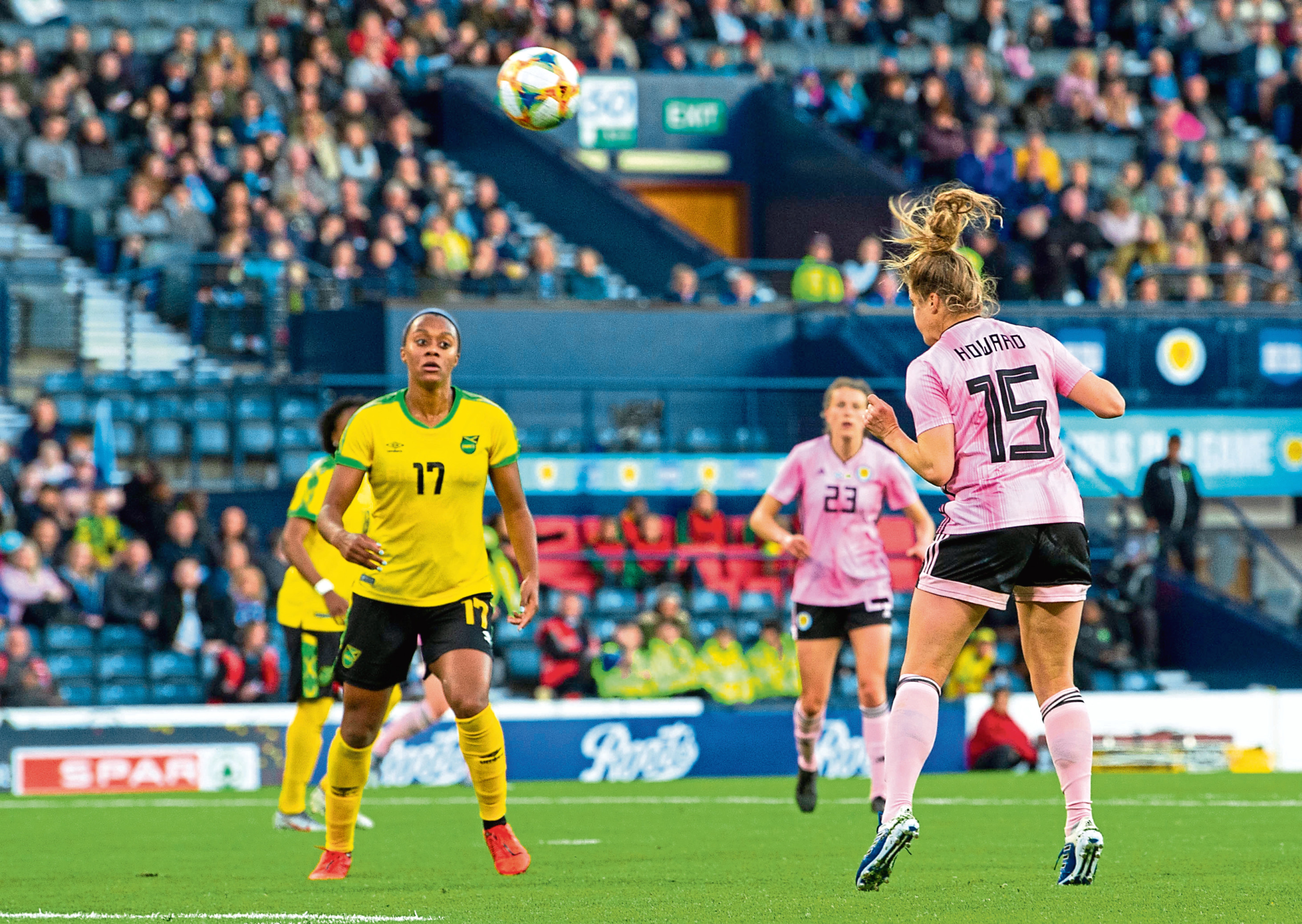 Scotland's Sophie Howard heads home to make it 3-2 in the recent game against Jamaica
