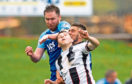Elgin's Callum Wilson in action alongside Peterhead's Mick Dunlop, left, and Jack Leitch.