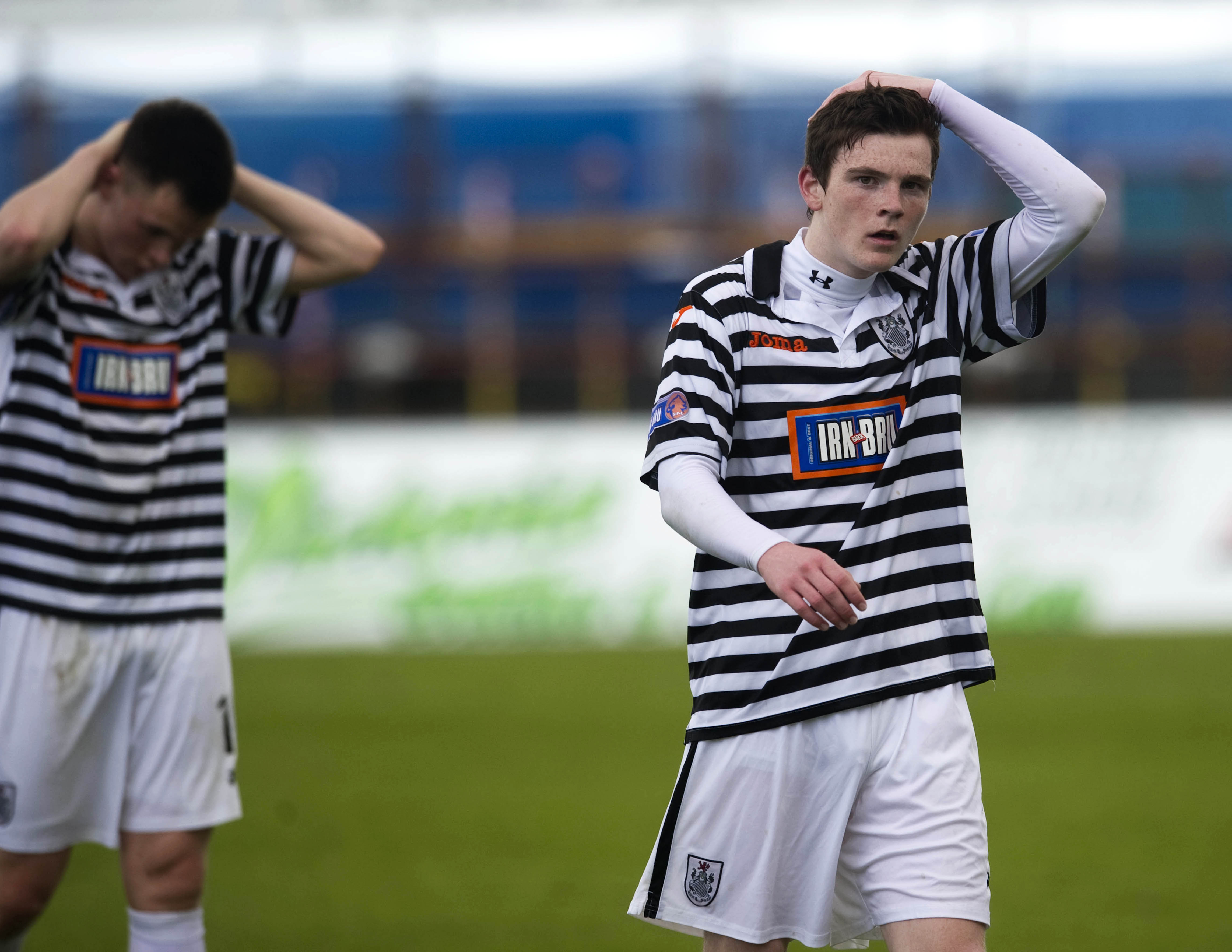 Queen's Park's Andrew Robertson trudges off as his side suffer defeat to Peterhead.