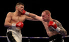 John Docherty and Przemyslaw Binienda during their super-middleweight contest at The O2 Arena, London.