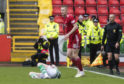 Aberdeen's Sam Cosgrove, right, catches Celtic's Jonny Hayes