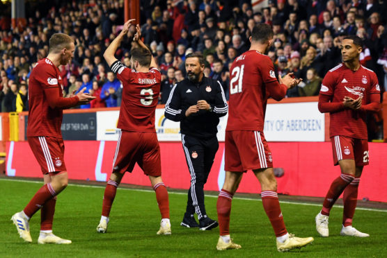 Aberdeen's Graeme Shinnie applauds the home support one last time after the post-split win over Hearts last season.