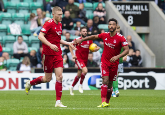 Shay Logan, right, in action for Aberdeen.