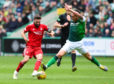 Hibernian's Mark Milligan, right, challenges Aberdeen's Graeme Shinnie during Sunday's win at Easter Road.