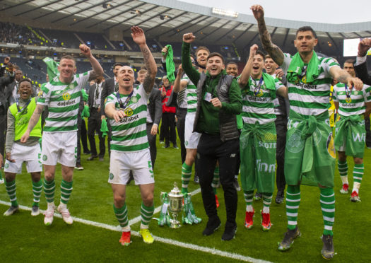 Celtic's players celebrate winning the William Hill Scottish Cup.