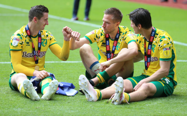Norwich City's Kenny McLean, Marco Stiepermann and imm Klose celebrate after winning Sky Bet Championship match at Villa Park, Birmingham.