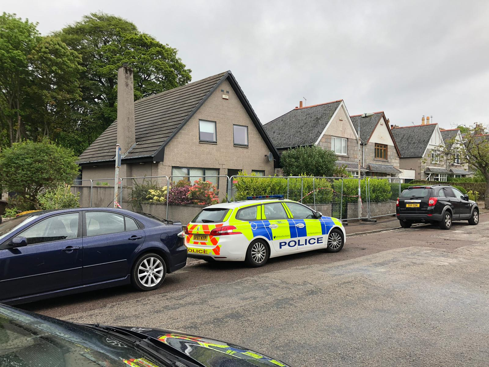 Police at the scene of the incident on Sycamore Place in Aberdeen