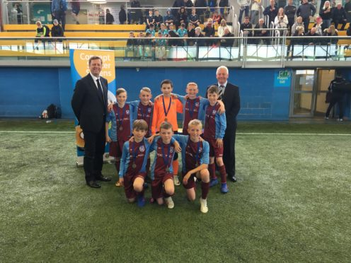 The winning team from Elrick Primary School with officials from the Scottish Schools Football Associaton