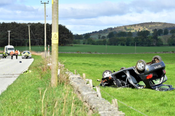 A woman was seriously injured when the car she was in crashed into a wall on the B9119 Garlogie to Echt road