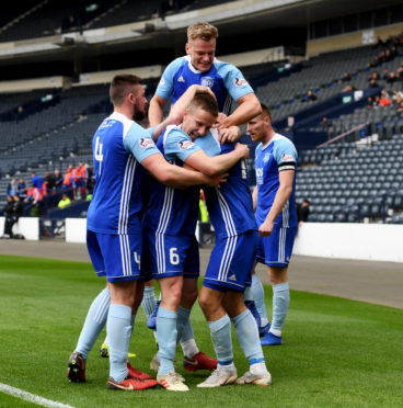 The Peterhead players celebrate Jack Leitch's opening goal at Hampden against Queen's Park