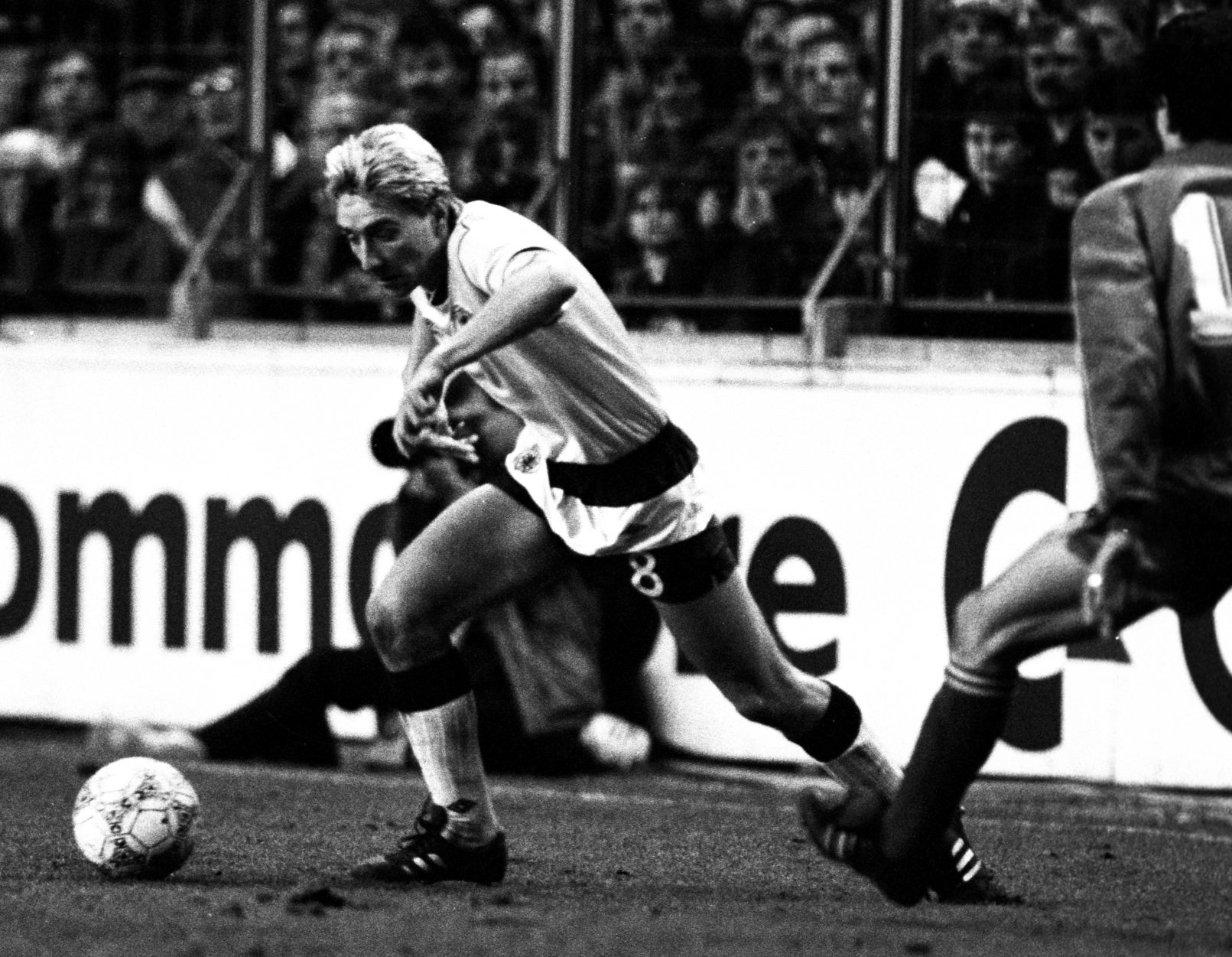 Jim McInally in action for Scotland.