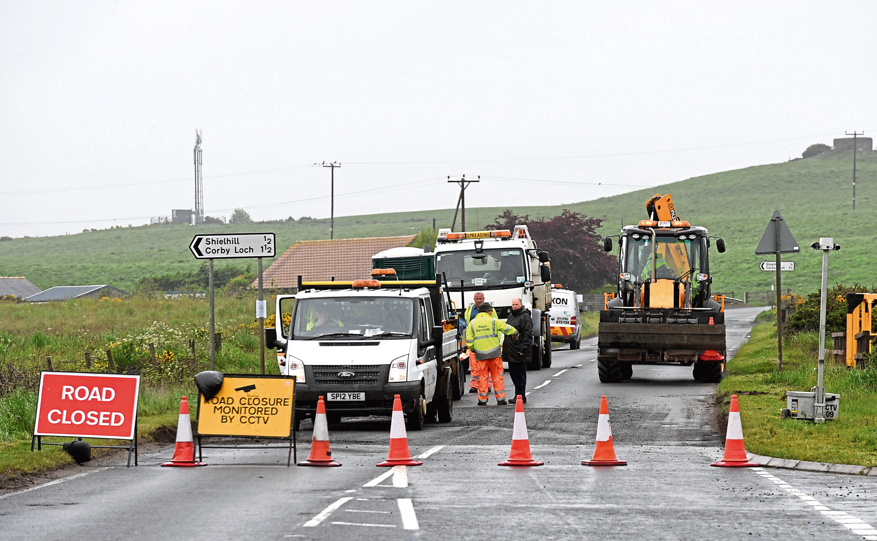Workers resurfacing the B999 near the Sheilhill junction.