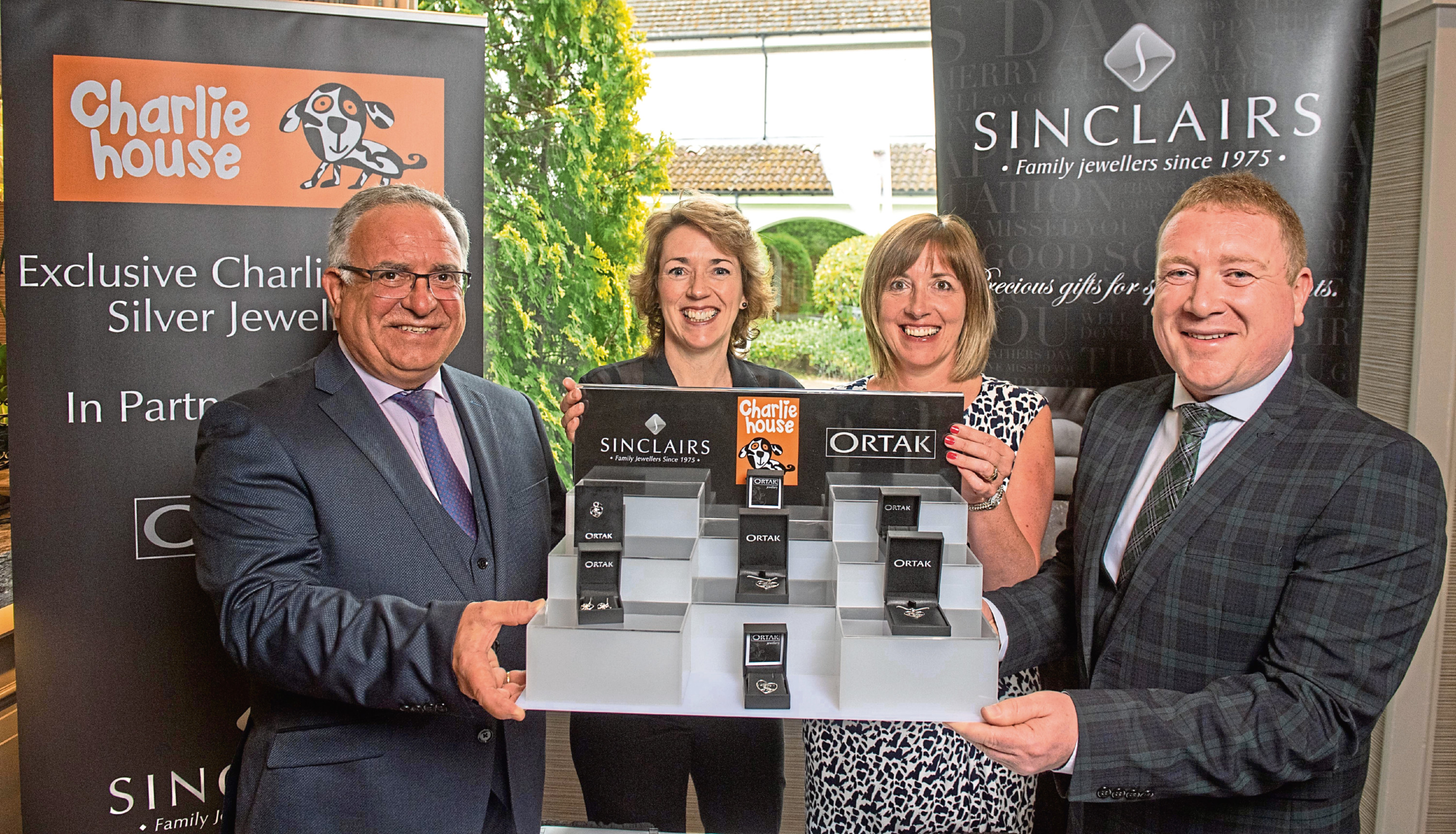 From left, Ian Sinclair, Tracy Johnstone, chairwoman of Charlie House, Susan Crighton, and Michael Gardens with some of the new jewellery collection, inset left