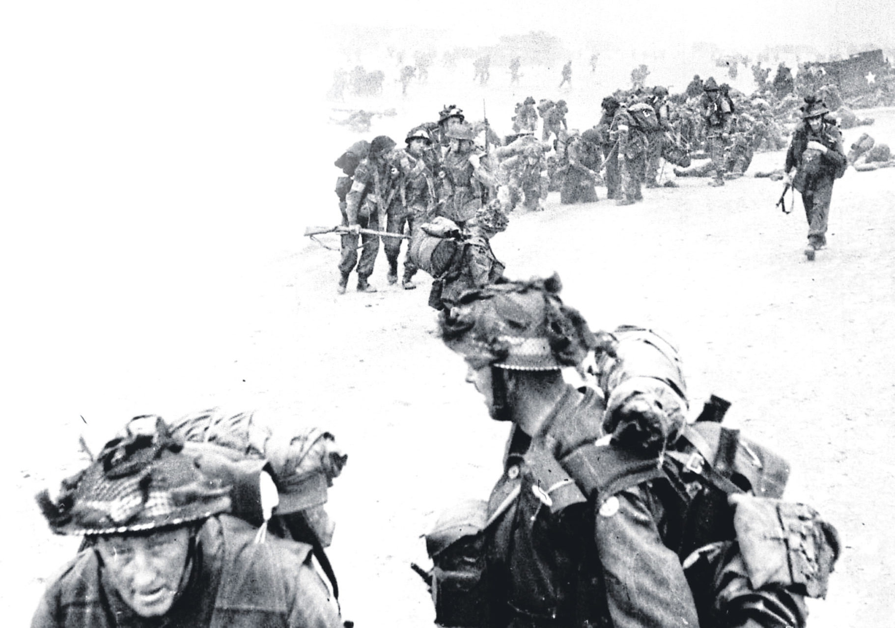 Allied Forces emerging from the sea to begin the landings in Normandy