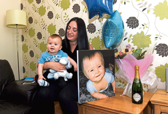 Snappy Tots winner Scott Bruce and mum Sarah surprised at their home.
