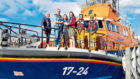 Rebecca Laird donates money to the crew of Aberdeen Lifeboat