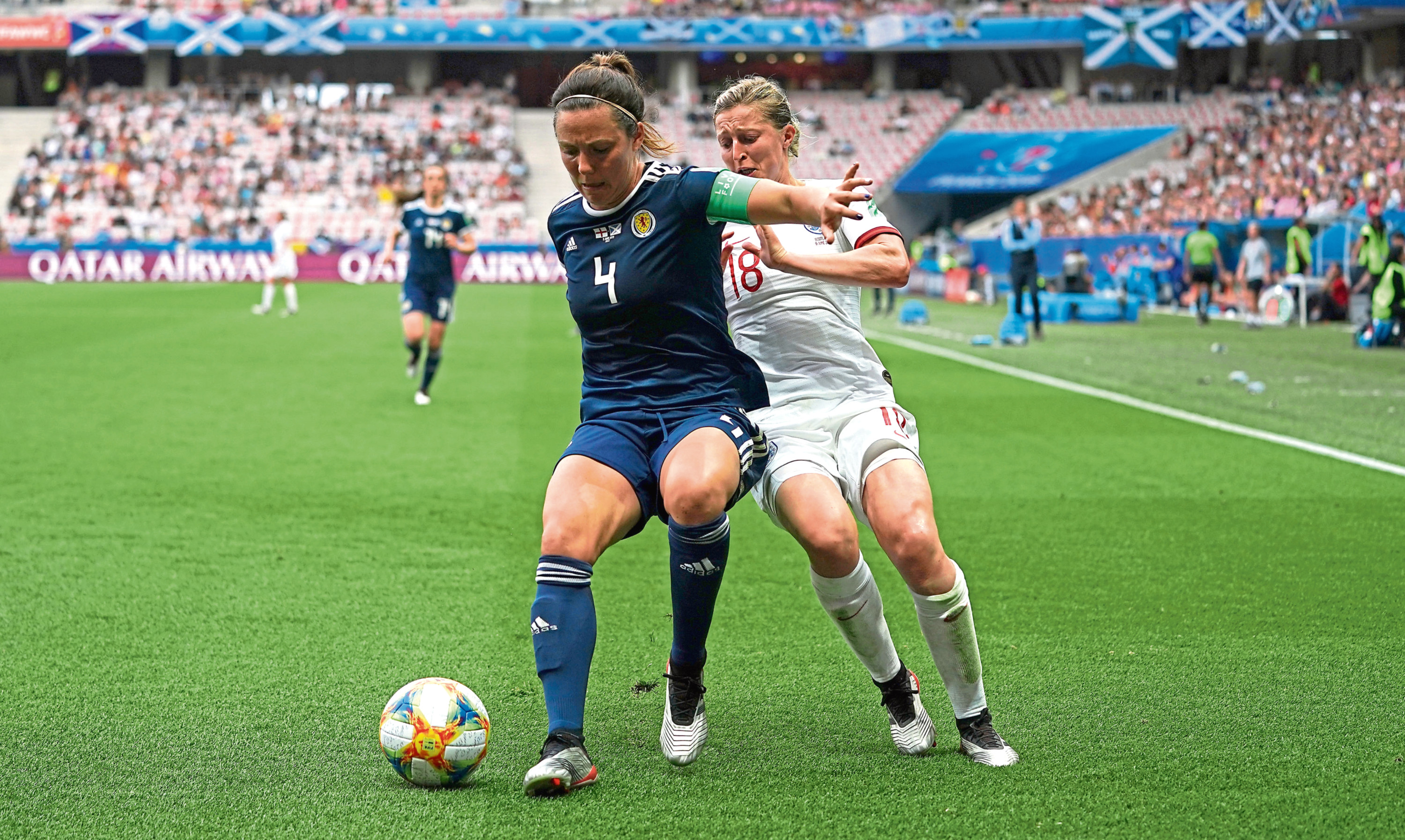 Scotland's Rachel Corsie and England's Ellen White  battle for the ball during the FIFA Women's World Cup last year.