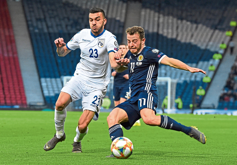 Scotland's Ryan Fraser, right, slides in with Cyprus' Ioannis Pittas