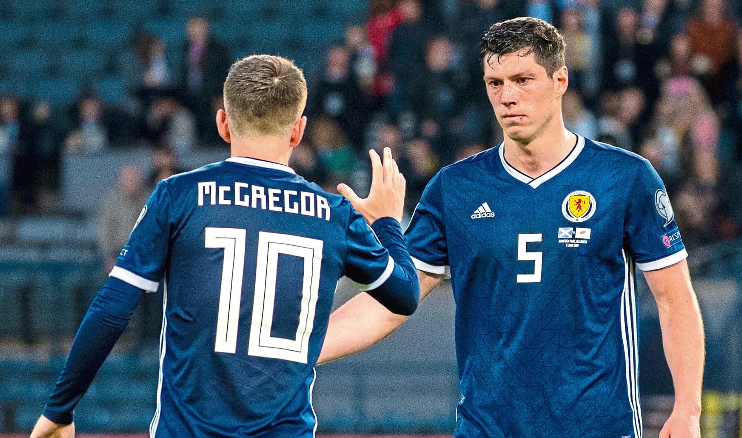 Scotland's Callum McGregor, left, and Scott McKenna embrace at full-time.