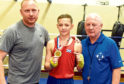 Sonny Kerr who has just won the British title in Cardiff, pictured with his dad, Kevin Kerr and grandad Tony Kerr at the Byron Boxing Club, Aberdeen