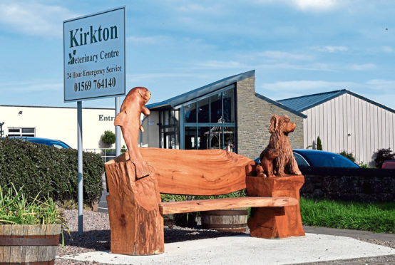 The bench features a carved spaniel, a salmon and rabbit in tribute to Allan Annat