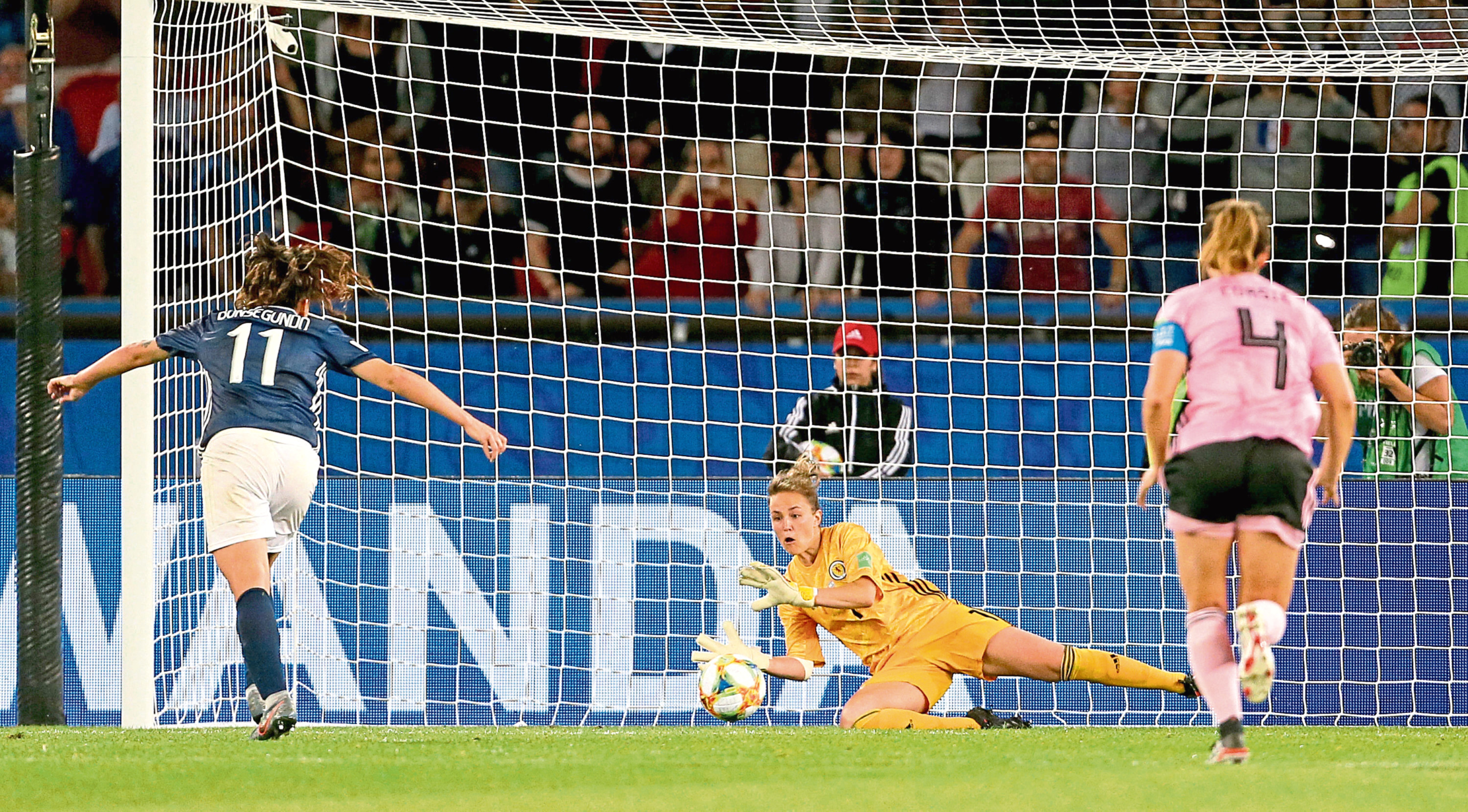 Scotland goalkeeper Lee Alexander saves a penalty from Argentina's Florencia Bonsegundo, but is off her line so it is ordered to be re-taken, during the FIFA Women's World Cup, Group D match at the Parc des Princes, Paris.