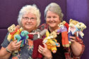 Councillor Anne Simpson with Councillor Anne Stirling holding some of the many knitted bears created by knit and natter groups