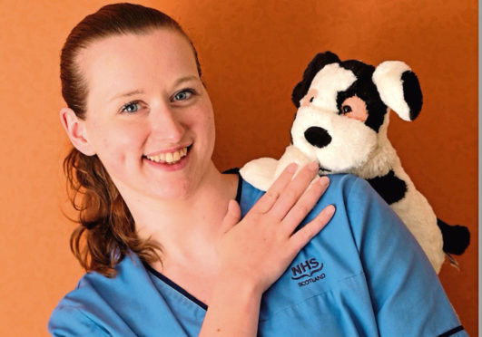 Community nurse Fiona Fairley with charity mascot Charlie Dog
