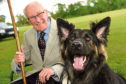 Legendary musician Robbie Shepherd with the guide dog