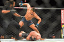 Johnny Walker punches a downed Misha Cirkunov during his first round TKO win at UFC 235 at the T-Mobile Arena in Las Vegas