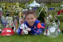 Aston Sharp with his collection of trophies and medals