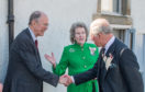 Prince Charles introduced to vice-Lieutenant of Banffshire Roger Goodyear by Clare Russell Lieutenant of Banffshire weeks before Mr Goodyears death