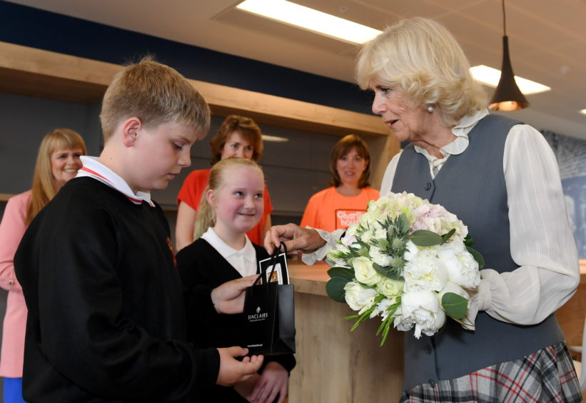 Camilla was presented with gifts by the Junior Journalists Finlay Mannion and Ava Duncan of Culter School